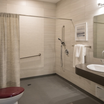 Ensuite accessible bathrooms provide ample space for caregivers and easy access showers